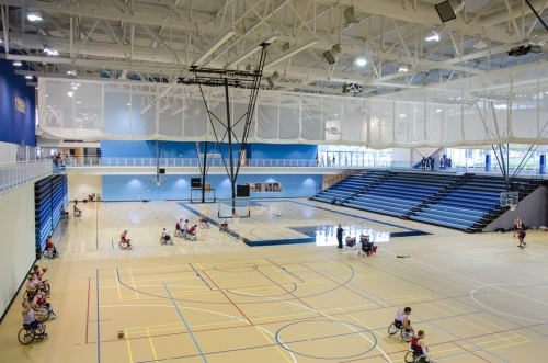 One of multiple gymnasia in the Toronto Pan Am Sports Centre. Permanent retractable and temporary seating line the walls. Photo by Stephanie Calvet.