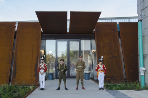 Entry to Fort York Visitor Centre, framed by a weathering steel panel façade. Photo by Stephanie Calvet.