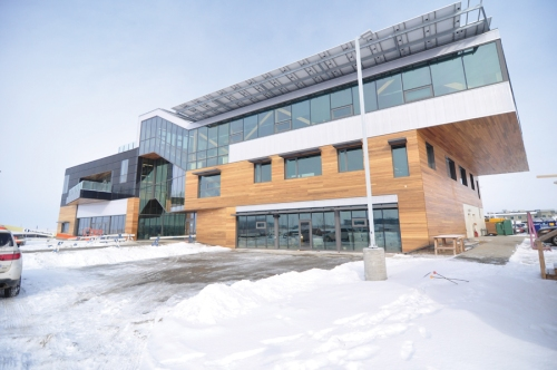 A view of the Mosaic Centre for Conscious Community and Commerce in Edmonton, designed by Manasc Isaac Architects to Passivhaus targets, and supplemented with active solar components. Photo by Sonny Shem