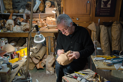 Guy Levesque crafting another of his extraordinary hand carved molds.